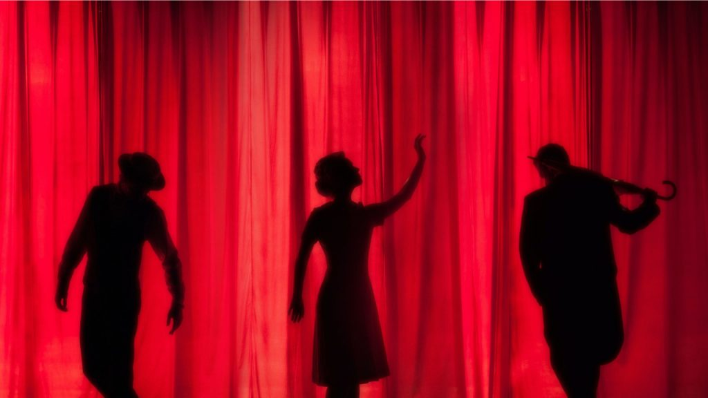 Human Shadows on Red Background. Theatre Scene.