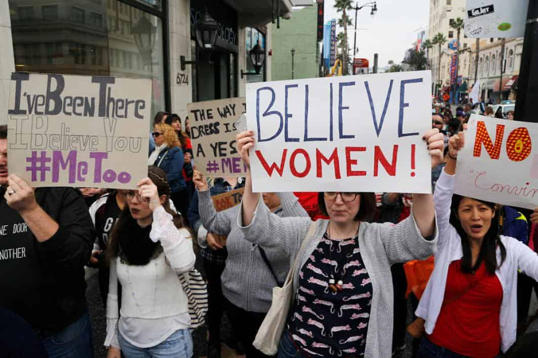 March for Women protesters holding Believe Women Signs