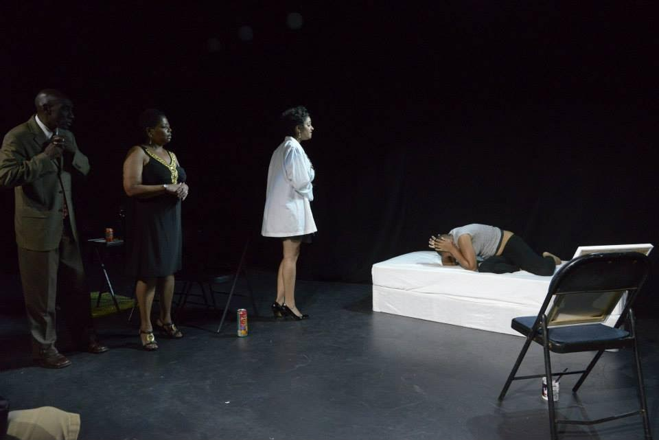 The first scene of the play when Morgan wakes up in the St. Elizabeth's Psychiatric Hospital, confronted by her doctor and parents.