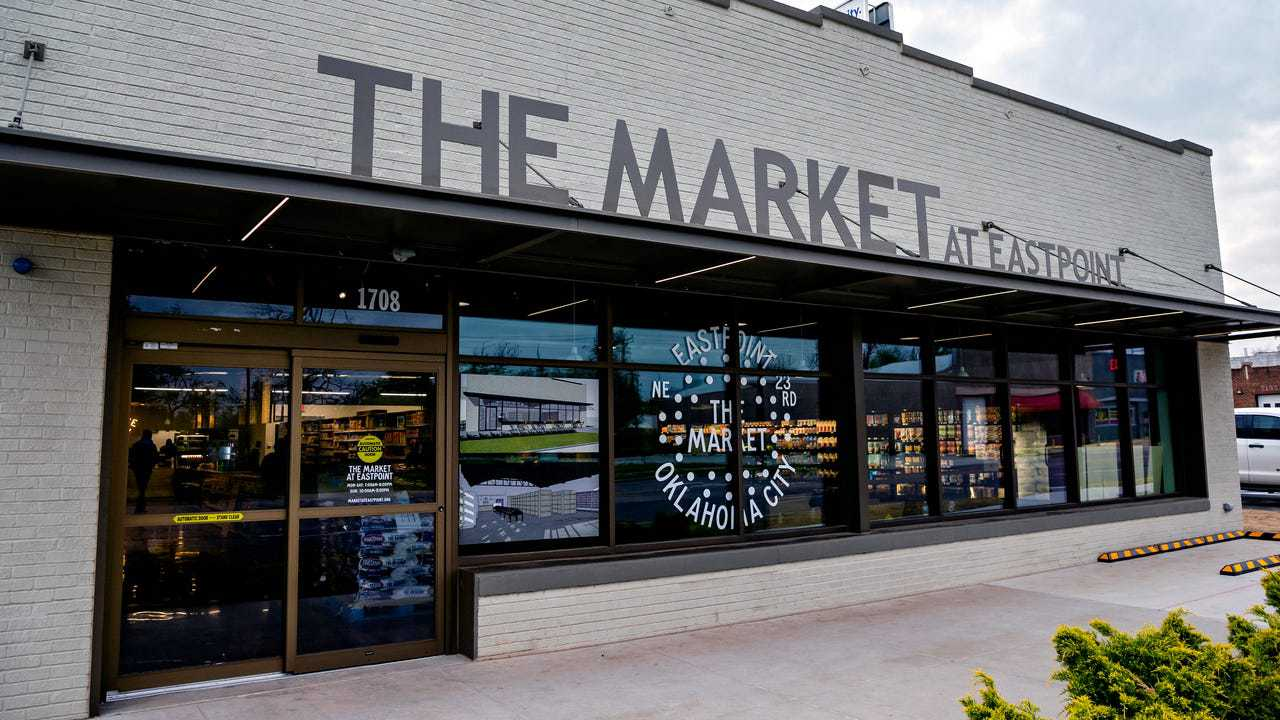 A photo depicting the front of The Market at EastPoint building, a new grocery store in a